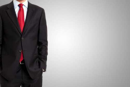 Businessman in front of a grey background
