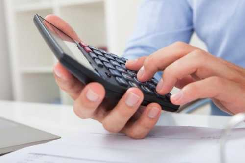Businessman Calculating Tax In Office