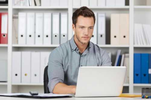 Businessman Using Laptop At Office