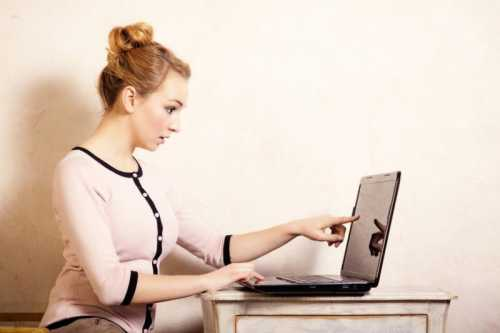 Businesswoman touching screen computer laptop